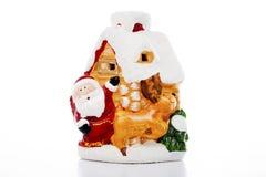 圣诞节克劳斯装饰圣诞老人 在被隔绝的白色背景的圣诞节小雕象 工作室照片 库存图片
