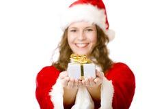 圣诞节克劳斯赠礼愉快的圣诞老人妇&# 图库摄影