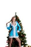 圣诞节冷杉女孩新的立场结构树年年&# 免版税库存图片