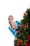 圣诞节冷杉女孩看起来性感的结构树 库存图片