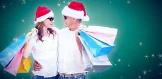 圣诞节加上的综合图象购物袋 库存图片