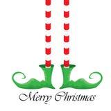 圣诞节动画片在白色背景的elfs腿 库存图片