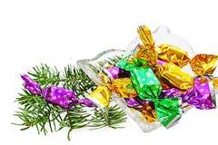 圣诞节包裹了被隔绝的糖果 免版税库存照片