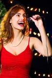 圣诞节卡拉OK演唱 免版税库存图片