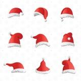 圣诞节各种各样的帽子在白色背景的动画片样式设置了 皇族释放例证