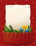 圣诞节名单的纸在被编织的口袋 库存照片