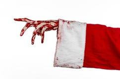 圣诞节和万圣夜题材:在白色背景的圣诞老人蛇神血淋淋的手 免版税库存照片