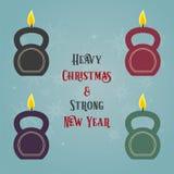 圣诞节和新年与kettlebells的贺卡传统化了作为蜡烛 免版税库存图片