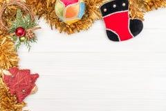 圣诞节和新年装饰由与新年装饰品的壁角框架制成 库存图片