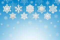 圣诞节和新年装饰:雪花小雕象在b的 免版税库存照片