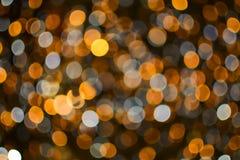 圣诞节和新年金子和白色bokeh光背景 库存照片