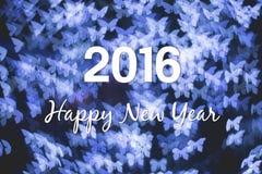 圣诞节和新年在蓝色蝴蝶的贺卡点燃bokeh 免版税库存图片