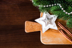 圣诞节和新年烹调和装饰在木背景 免版税图库摄影