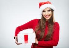 圣诞节圣诞老人帽子查出妇女纵向暂挂圣诞节礼品 免版税库存图片