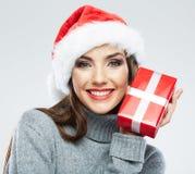 圣诞节圣诞老人帽子查出妇女纵向暂挂圣诞节礼品 库存照片