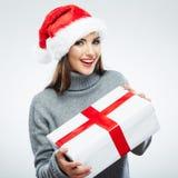 圣诞节圣诞老人帽子查出妇女纵向暂挂圣诞节礼品 库存图片