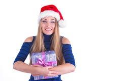圣诞节圣诞老人帽子查出妇女纵向暂挂圣诞节礼品 图库摄影