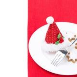圣诞节在一块红色餐巾的桌设置,被隔绝 库存照片