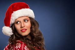 圣诞节在妇女的圣诞老人帽子 库存图片