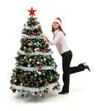 圣诞节在常设结构树妇女附近装饰了 免版税库存图片