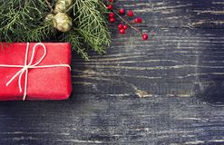 圣诞节在木背景的礼物盒 免版税图库摄影