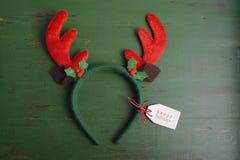 圣诞节在木背景的驯鹿耳朵 库存照片