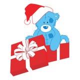 圣诞节在礼物的玩具熊 免版税库存图片