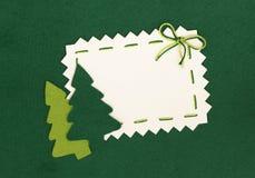 圣诞节在绿色的明信片和新年度结构树 免版税库存照片