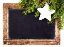 圣诞节在葡萄酒圣诞节黑板框架isol的冷杉分支 库存照片