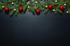 圣诞节在黑黑板的装饰背景 免版税库存照片