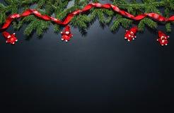 圣诞节在黑黑板的装饰背景 库存图片