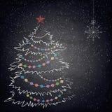圣诞节在黑板背景的图画树 库存照片