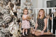 圣诞节在结构树附近的女儿母亲 免版税库存照片