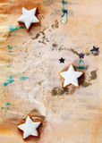 圣诞节在grunge的星形曲奇饼 库存照片
