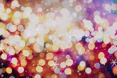 圣诞节墙纸装饰概念 假日节日背景:闪闪发光圈子被点燃的庆祝显示 图库摄影