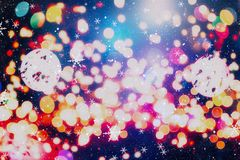圣诞节墙纸装饰概念 假日节日背景:闪闪发光圈子被点燃的庆祝显示 免版税图库摄影