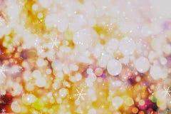 圣诞节墙纸装饰概念 假日节日背景:闪闪发光圈子被点燃的庆祝显示 库存照片