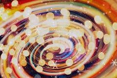 圣诞节墙纸装饰概念 假日节日背景:闪闪发光圈子被点燃的庆祝显示 免版税库存图片