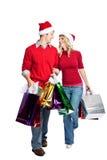 圣诞节夫妇购物 免版税库存照片