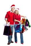 圣诞节夫妇购物 免版税图库摄影