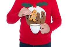 圣诞节套头衫和姜饼人。 免版税库存照片