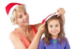 圣诞节女儿帽子一起照顾 图库摄影