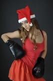 圣诞节女孩佩带的拳击手套 库存图片