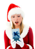 圣诞节女孩开张的存在惊奇了 免版税库存照片