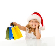 圣诞节女孩愉快的一点购物 免版税库存照片