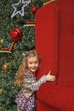 圣诞节女孩结构树 图库摄影