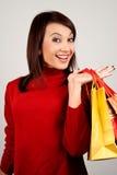 圣诞节女孩购物年轻人 免版税库存照片