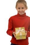 圣诞节女孩金存在红色年轻人 免版税库存照片