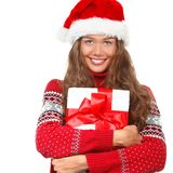 圣诞节女孩,圣诞老人`的s h年轻美丽的微笑的少妇 免版税库存照片