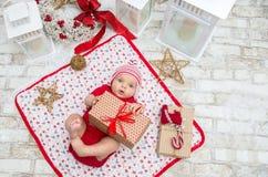 圣诞节女婴在圣诞节的前夕六个月 免版税库存照片